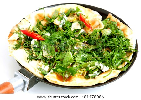 Thin armenian pita bread with cheese, pepper and herbs for backing