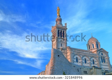 Thin clouds decorate the sky above the Church Notre Dame de la Garde at sunset, Marseille, France - stock photo