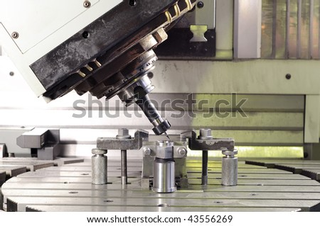 metal mill. thin mill installed in spindelhead cutting the metal blank fixed attachment