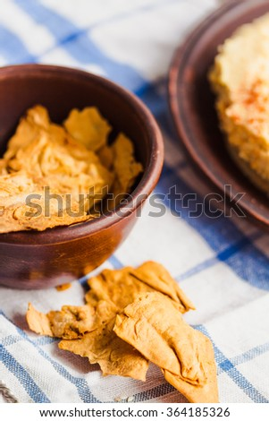 thin pita chips with spices, vegan snack with hummus of chickpeas,vegan snack - stock photo