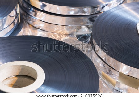 Thin reel of a polypropylene tape. - stock photo