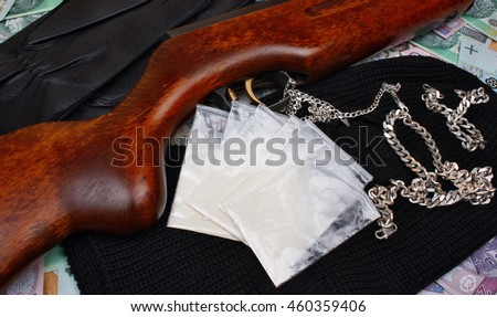 Things bandit criminal drug dealer gun, balaclava, gloves polish money on the table - stock photo