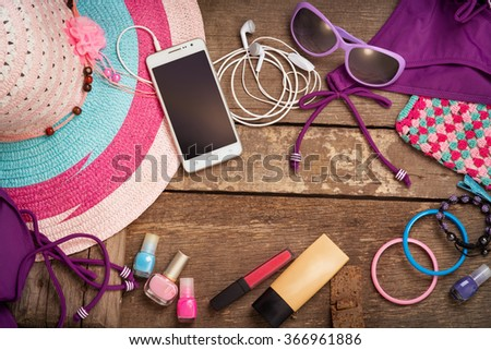 Things for the beach young woman on the old boards - stock photo