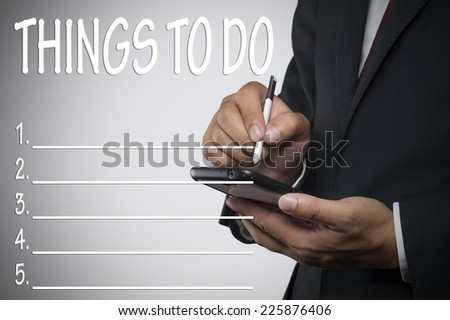 Things to do,Executive holding Smartphone - stock photo