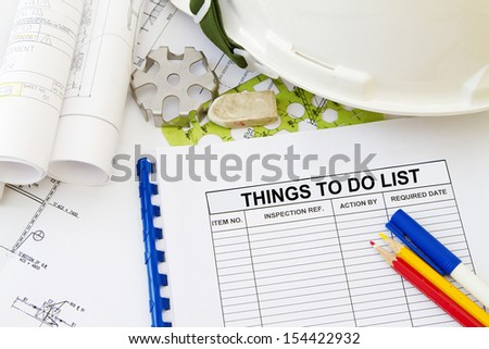 Things to do list abstract with engineering tools and hard hat.