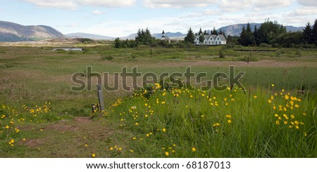 Thingvellir National park with village and white church in background, Iceland - stock photo