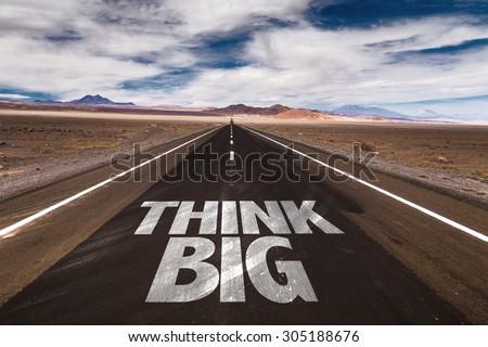 Think Big written on desert road - stock photo