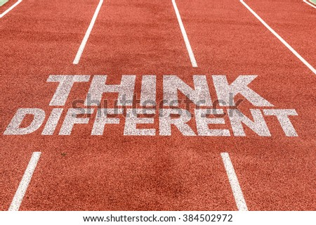 Think Different written on running track - stock photo