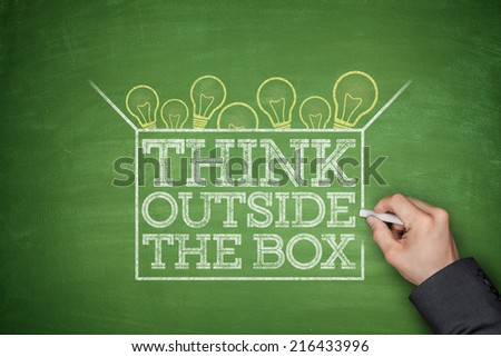 Think outside the box concept on green blackboard - stock photo