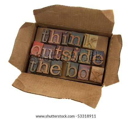 think outside the box concept, words  in vintage letterpress type  in open cardboard box, isolated on white - stock photo