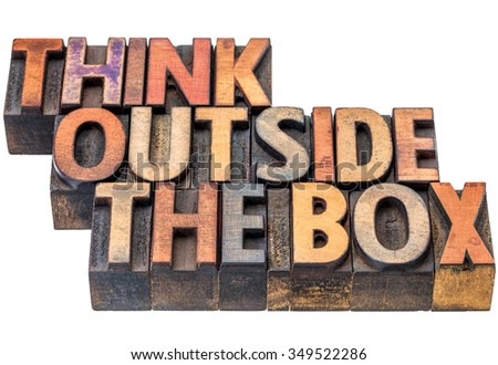 think outside the box - motivational phrase in vintage letterpress wood type, stained by ink, isolated on white - stock photo