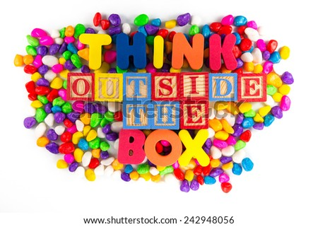 think outside the box word in colorful stone - stock photo