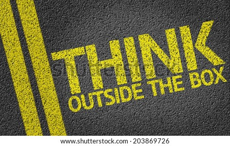 Think Outside the Box written on the road - stock photo