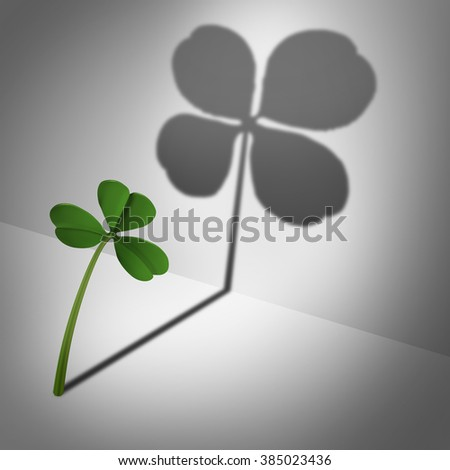 Think positive as an optimistic motivational concept or feeling lucky and positive thinking and inner confidence icon as a three leaf clover casting a shadow with four leaves as an optimism metaphor. - stock photo
