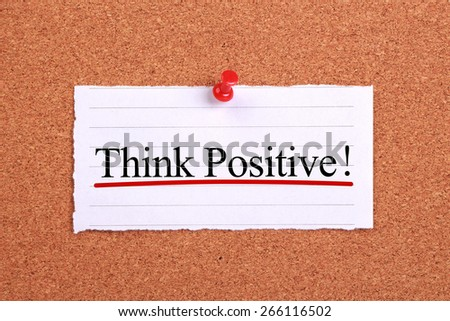 Think Positive text paper is pinned on cork. - stock photo