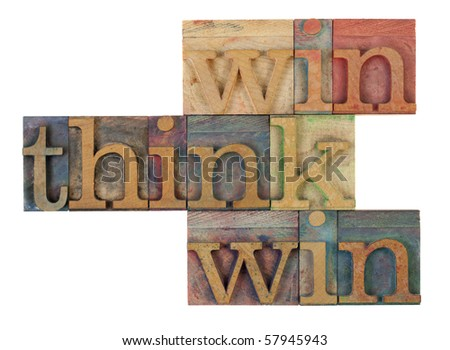 think win win words in vintage wooden letterpress printing blocks, stained by color inks, isolated on white - stock photo