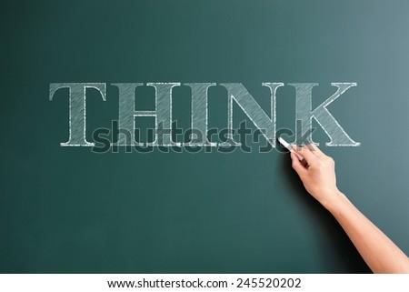 think written on blackboard - stock photo