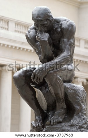 Thinker full body by Rodin - stock photo