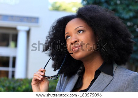Thinking African American Professional Business Person Pretty Beautiful Wearing Black Shirt and Suit - stock photo