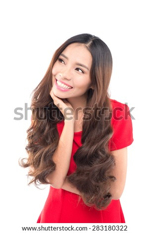 Thinking beautiful young woman looking to the side at white copyspace. Funky fresh and playful multiracial Asian Chinese / Caucasian smiling happy and joyful on white background. - stock photo
