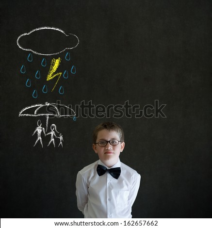 Thinking boy dressed up as business man thinking about protecting family from natural disaster on blackboard background