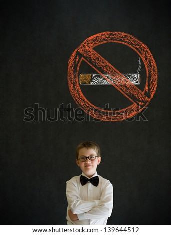 Thinking boy dressed up as business man with no smoking chalk sign on blackboard background - stock photo