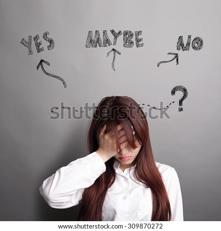 Thinking business woman and feel unhappy isolated on grey background with finger at face, asian beauty - stock photo
