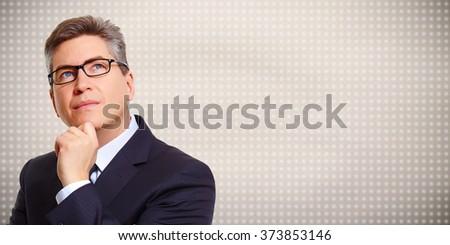 Thinking businessman. - stock photo