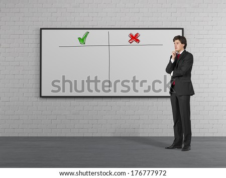 Thinking businessman in front of whiteboard - stock photo