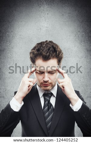 thinking businessman on a gray background