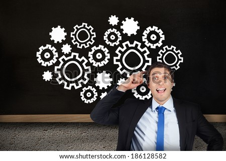 Thinking businessman scratching head against chalkboard on grey wall - stock photo
