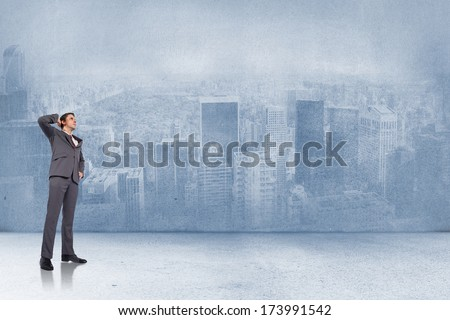 Thinking businessman scratching head against city scene in a room