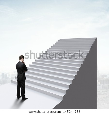 thinking businessman standing near ladder - stock photo