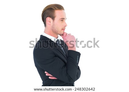 Thinking businessman standing with hand on chin on white background