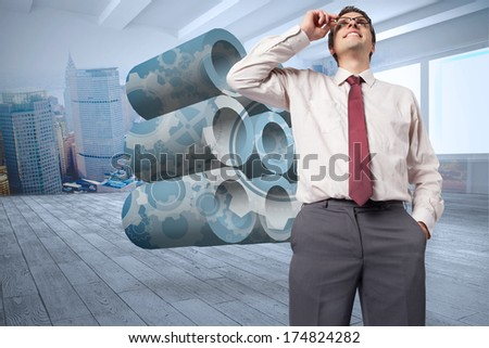 Thinking businessman touching his glasses against city scene in a room - stock photo