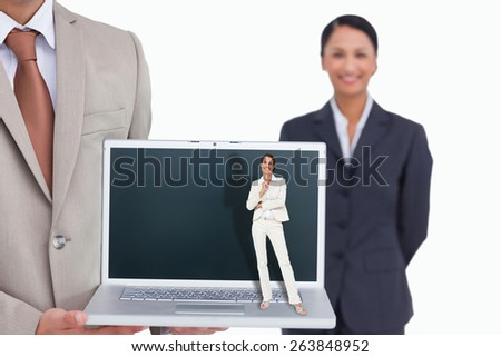 Thinking businesswoman against laptop being presented by salesman with colleague behind him