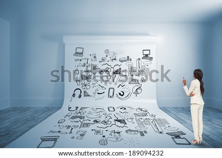 Thinking businesswoman against large white screen showing doodle