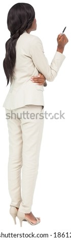 Thinking businesswoman in cream suit on white background - stock photo