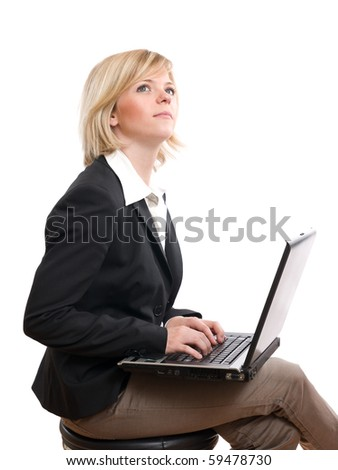 thinking businesswoman typing on her laptop - stock photo
