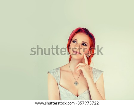 Thinking. Closeup portrait head shot happy mixed race daydreaming smiling cute confident latin female girl business woman isolated green grey background wall. Positive human emotion feeling expression - stock photo