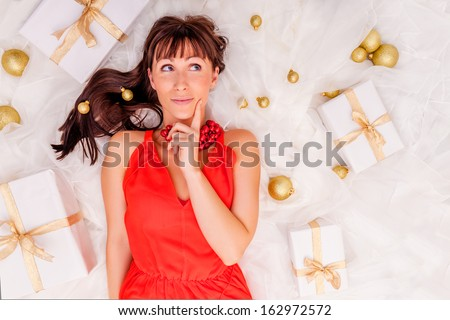 thinking gifts online shopping girl  - stock photo