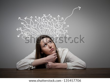 Thinking. Girl solving a problem. - stock photo