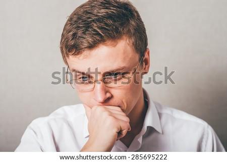 thinking guy in eyeglasses - stock photo