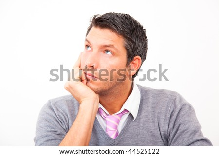 Thinking handsome man looking sideway wondering for ideas for business innovation - stock photo