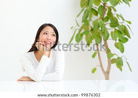 Thinking japanese woman - stock photo