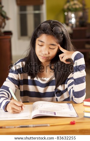 thinking kid, a girl thinking on her studying lesson. - stock photo