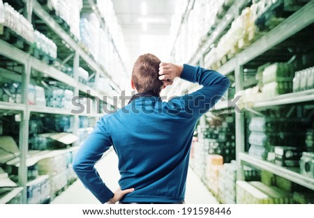 thinking man and shop warehouse background - stock photo