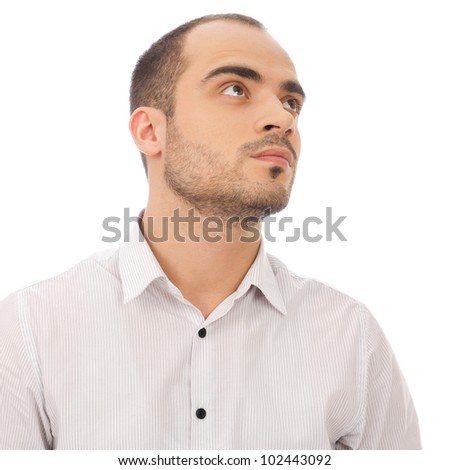 Thinking man isolated on white background. Closeup portrait of a casual young pensive businessman looking up. Caucasian male model.