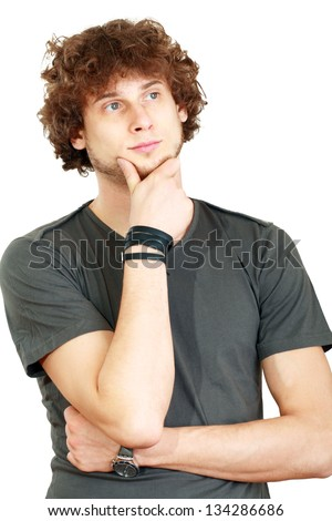 Thinking man isolated on white background. Closeup portrait of a casual young student - stock photo