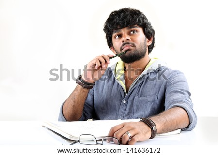 Thinking man isolated on white background. portrait of  an artist looking up - stock photo
